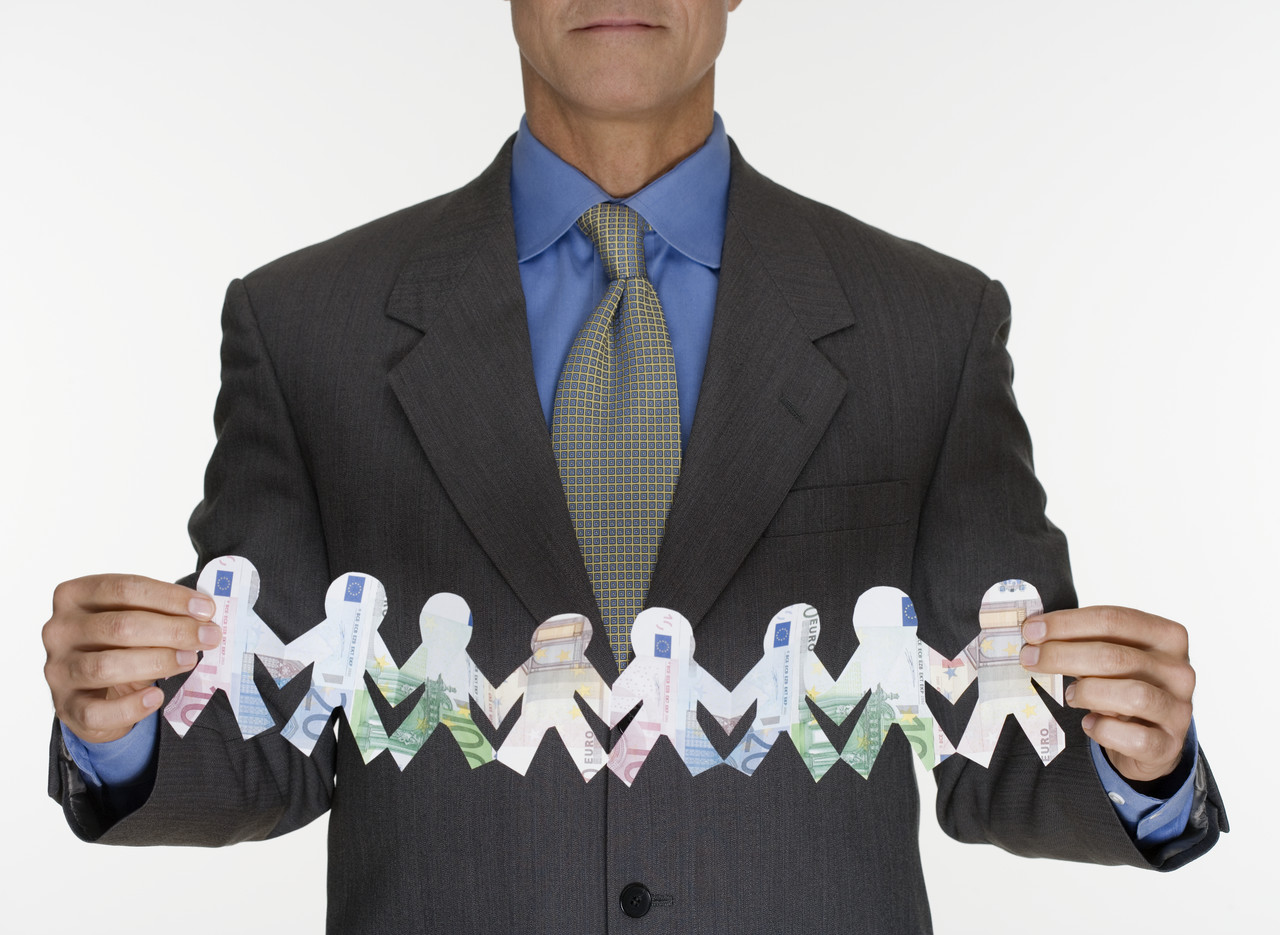 Businessman Holding Euro Paper Doll